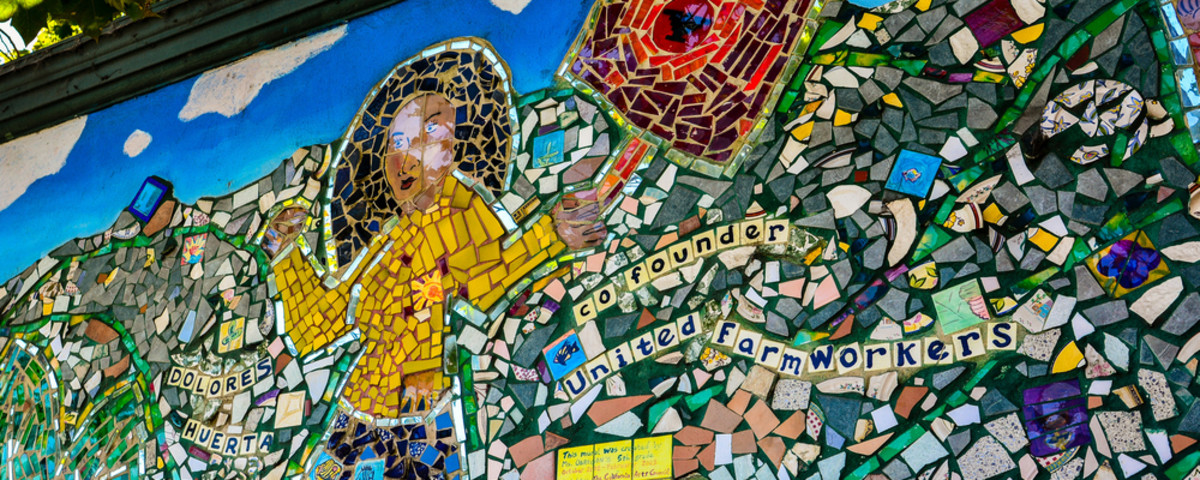 A tile street mural in San Francisco dedicated to Dolores Huerta, co-founder of United Farm Workers. (Photo: jejim/Shutterstock)