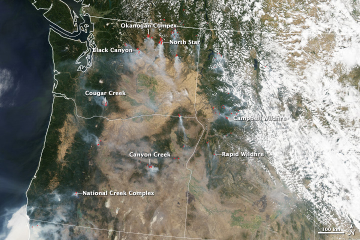 Satellite image taken during the day of August 18, 2015. Red dots signify high surface temperatures from the fires. (Photo: Jesse Allen and Joshua Stevens/NASA Earth Observatory)