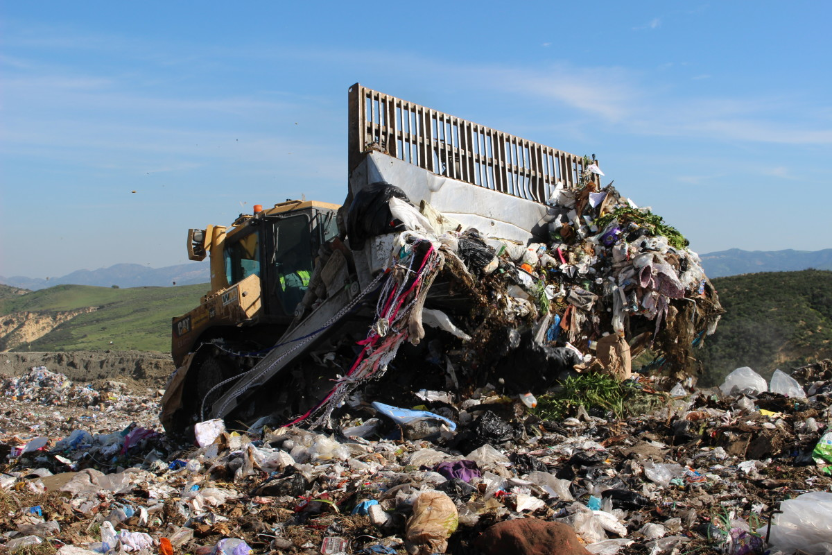 A bulldozer pushes garbage to the top of a trash hill at the Simi Valley Landfill. (Photo: Olga Grigoryants)