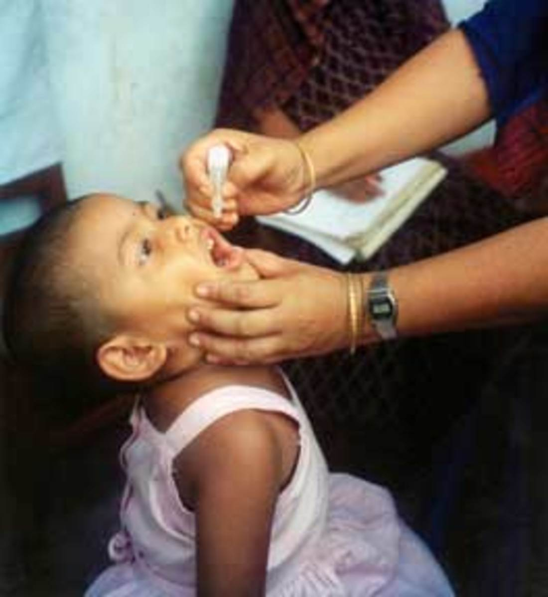 A child receiving an oral polio vaccine. (Photo: USAID/Wikimedia Commons)