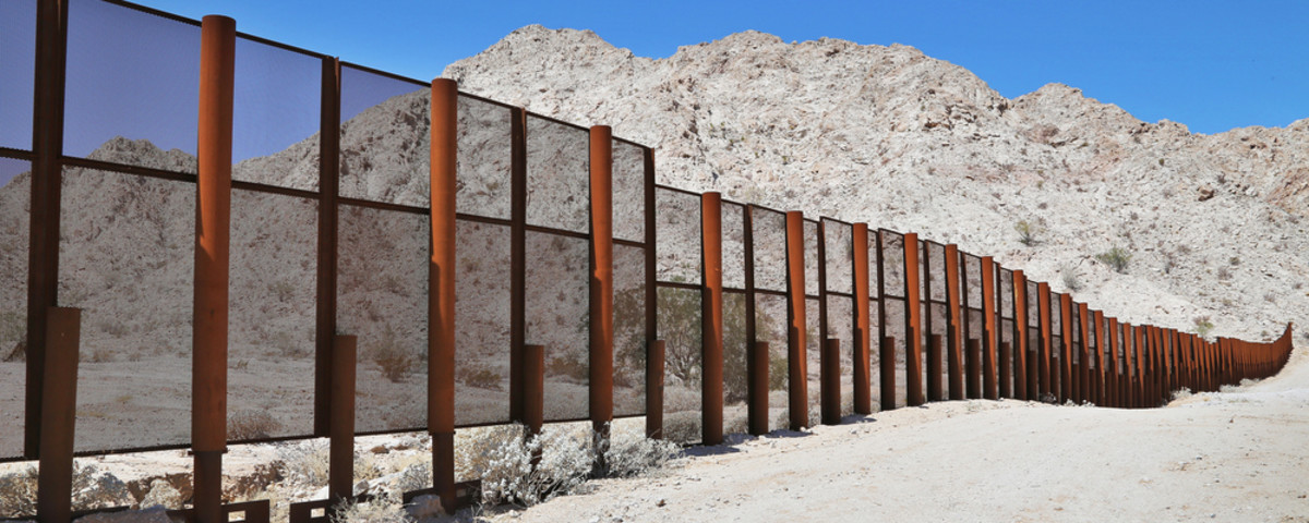 Large steel fence between Mexico and the United States in Arizona. (Photo: Ryan M. Bolton/Shutterstock)