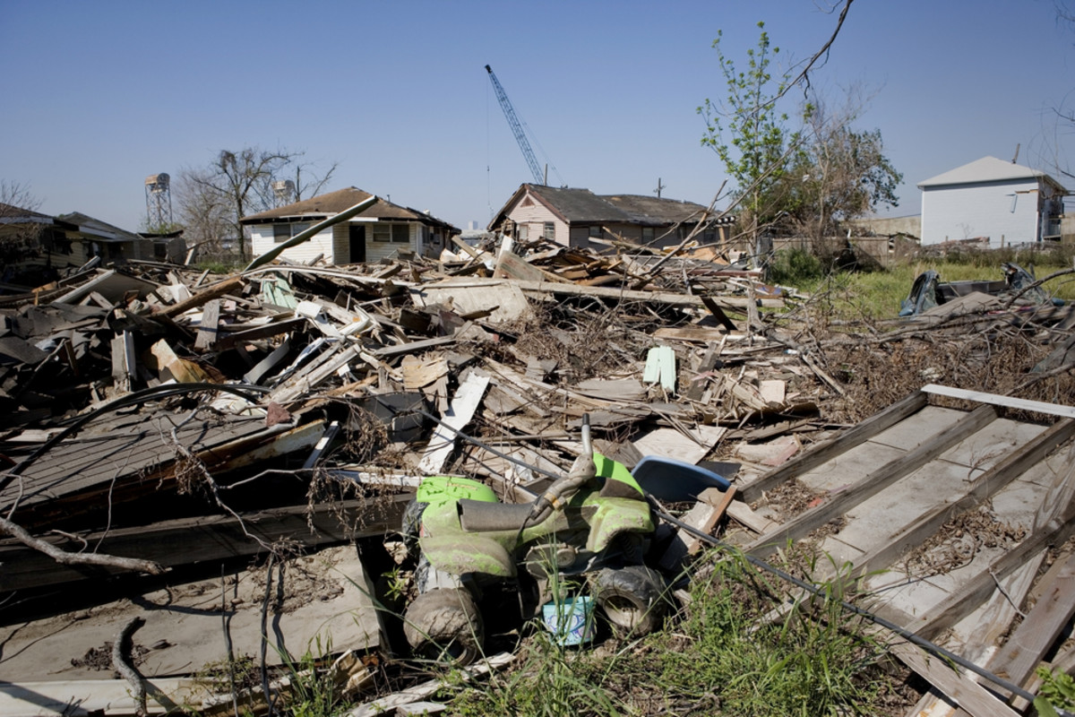 Heavily damaged homes in the Ninth Ward of New Orleans, Louisiana. One block behind these homes is the industrial canal that collapsed during the storm surge of Hurricane Katrina. (Photo: Brian Nolan/Shutterstock)
