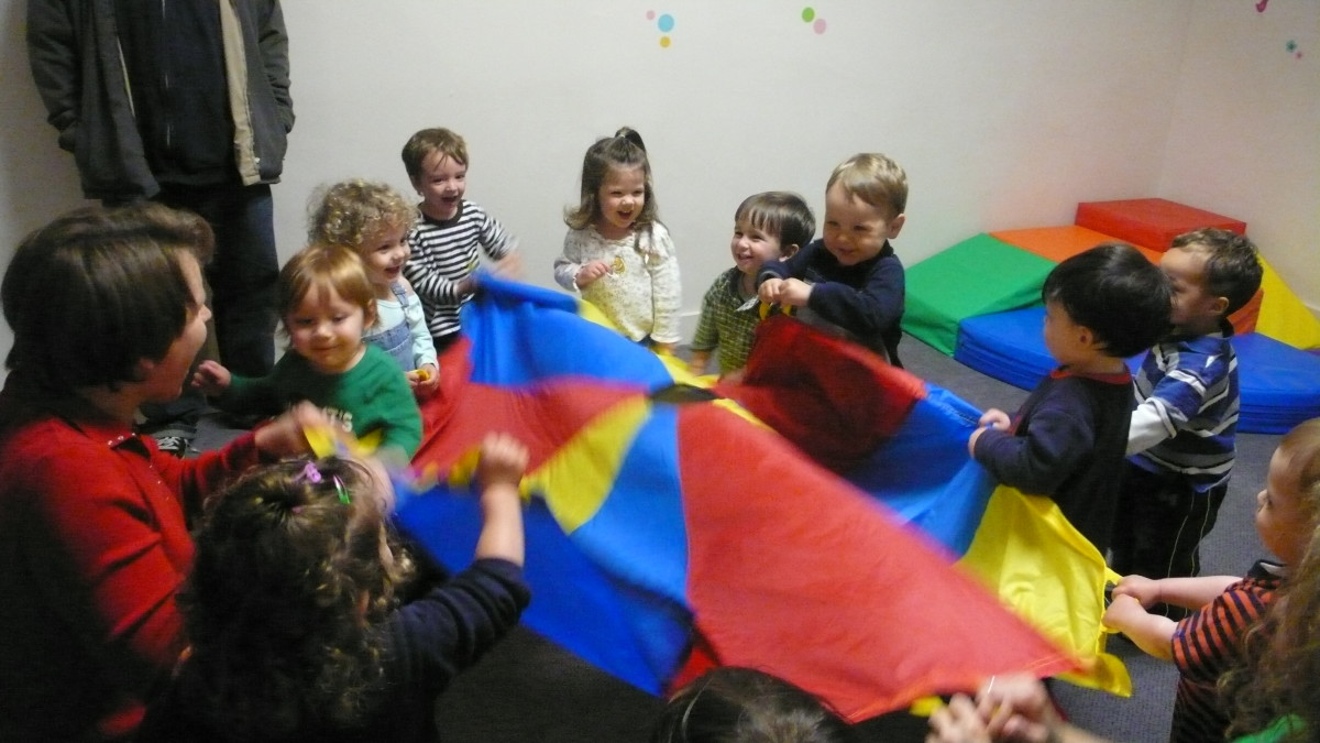 Children play under the supervision of a daycare staffer. (Photo: Grant Barrett/Wikimedia Commons)