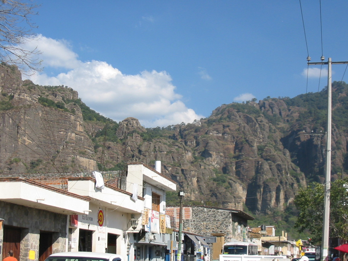 A view of the Tepozteco pyramid from Tepoztlán, Mexico. The pyramid is on the right side of the saddle in the cliff. (Photo: Public Domain)