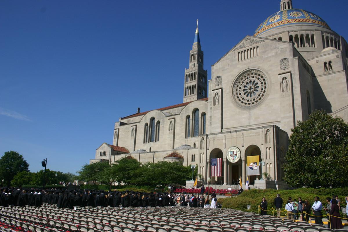 Graduates file to their seats as graduation ceremonies begin at the Catholic University of America in Washington, D.C. (Photo: L. Kragt Bakker/Shutterstock)