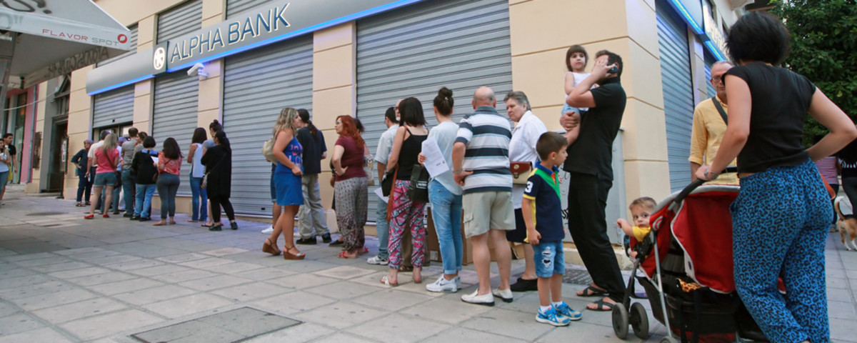 Citizens line up to use an ATM outside a closed bank in Thessaloniki, Greece. Cash machines ran dry after Greeks rushed to withdraw their savings from the banks. (Photo: Yiorgos GR/Shutterstock)