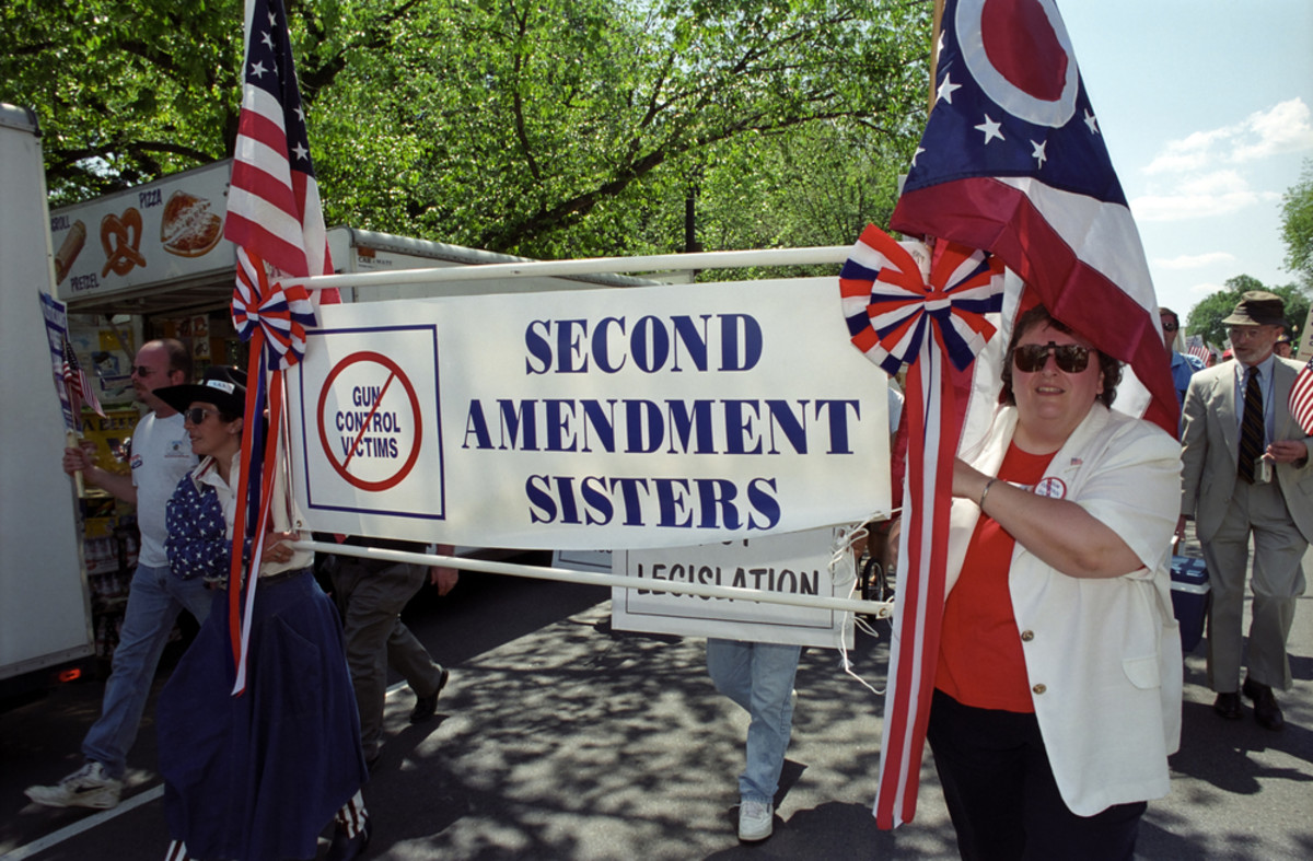 Pro-gun activists march as counter-protesters to the Million Mom March, a major rally for gun safety advocates on the National Mall in Washington, D.C. (Photo: Ryan Rodrick Beiler/Shutterstock)