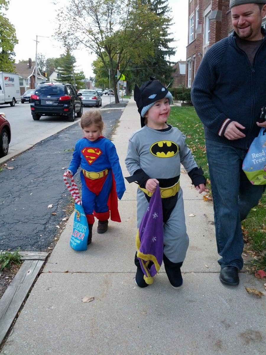 Ellie (Superwoman), trick-or-treating with Nico (Batman). (Photo: David M. Perry)