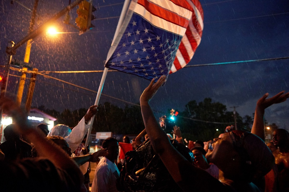 Demonstrators participate in a protest march on West Florissant Avenue in Ferguson, Missouri, on August 9th, 2015.