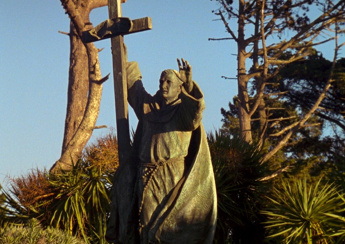 Contemplative long shots of California's El Camino Real highway and statues of Junipero Serra feature in Jenni Olson's new film, The Royal Road.