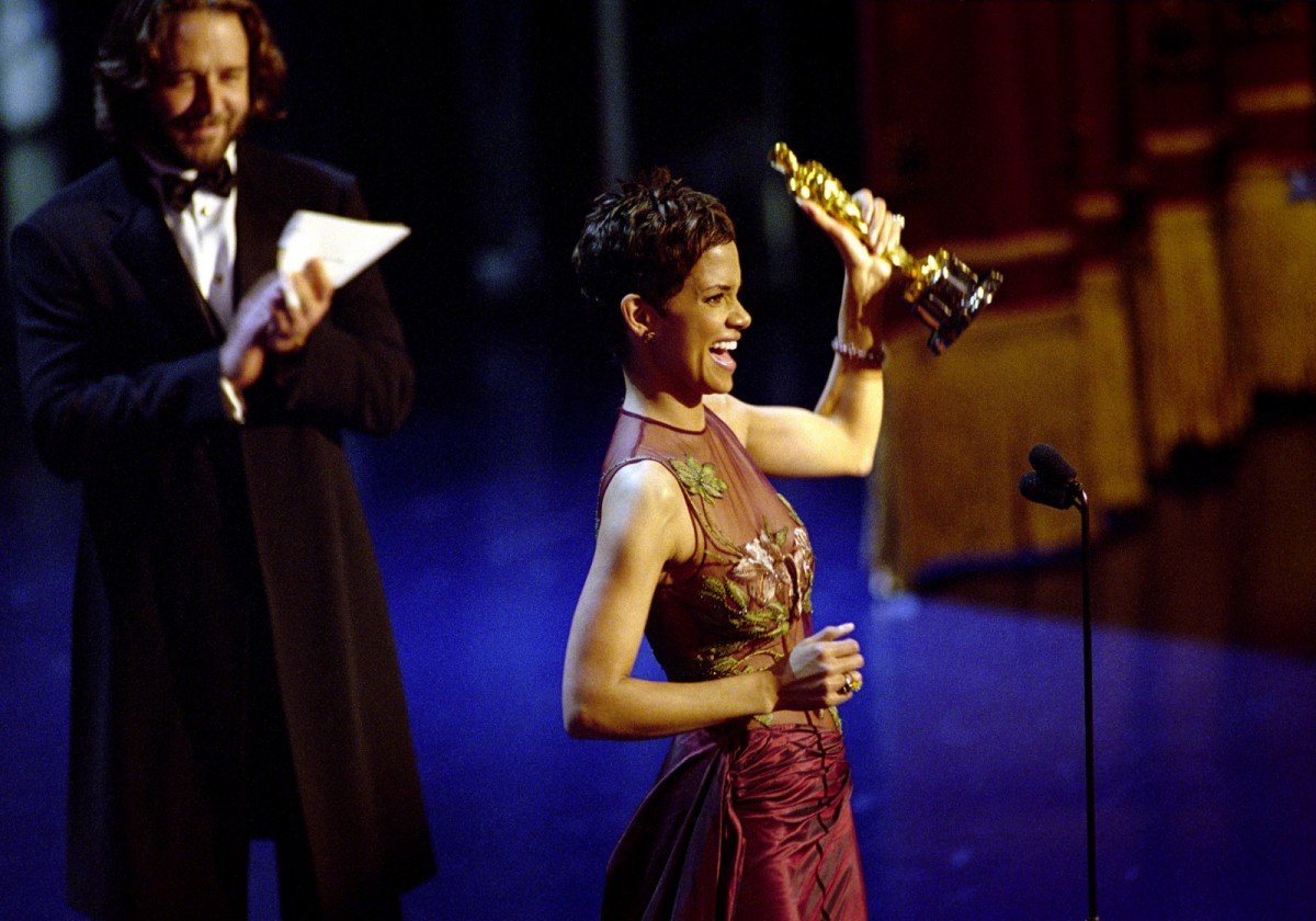Halle Berry accepts the Best Actress Academy Award for her performance in Monster's Ball during the 74th annual Academy Awards in 2002.