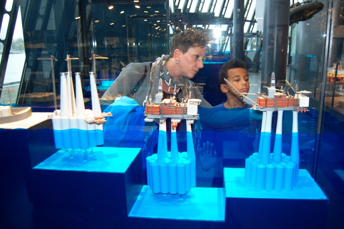 Visitors at the Norwegian Petroleum Museum studying the miniature replica of an oil platform, November 12th, 2015.