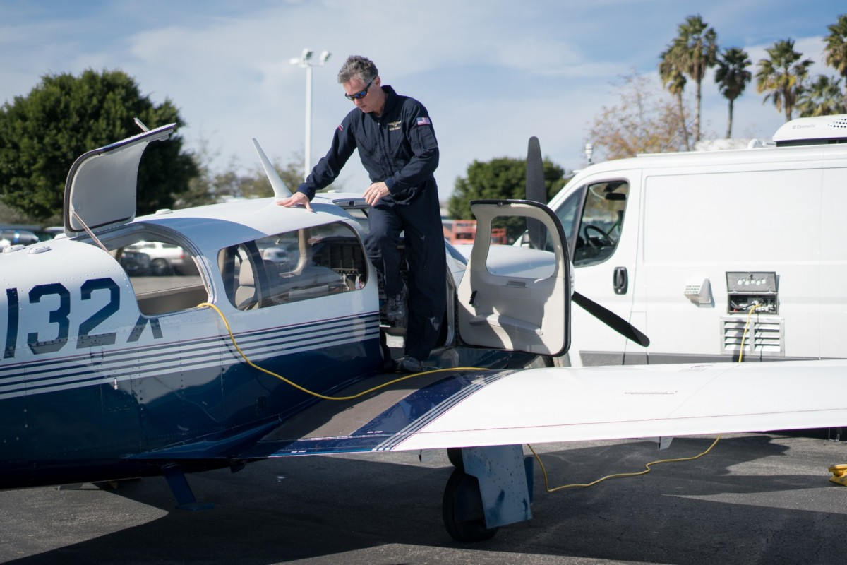 "University of California-Davis scientist and pilot Stephen Conley steps over cables transferring data from instruments on his plane at Van Nuys airport on January 21st after making another flight over Aliso Canyon to measure methane emissions from the gas leak. Conley was one of the first scientists to sound alarms to the public about the massive scale of the leak and has been making flights for several weeks to gather data. The flight path goes through windy canyons and heavy turbulence before reaching the invisible cloud of methane and its accompanying foul-smelling compound mercaptan, which is a chemical added to make the odor of natural gas detectable. ""I've had seven people, other researchers mostly, join me on the flights, and all seven of them have gotten sick on the ride,"" he says. ""I guess I've got a strong stomach."""
