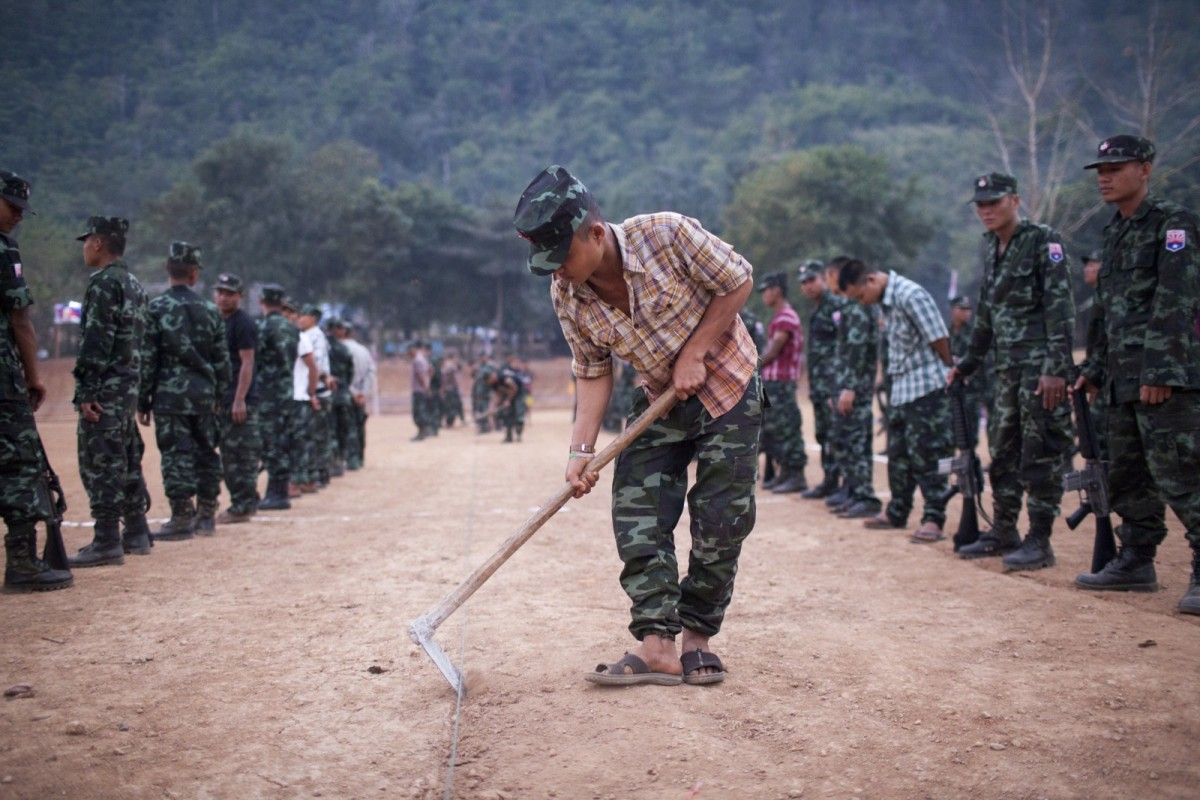 A Karen National Liberation Army soldier preparing the ground ahead of celebrations marking the 66th Karen Revolution Day in Myanmar's eastern Karen state in January of 2015.