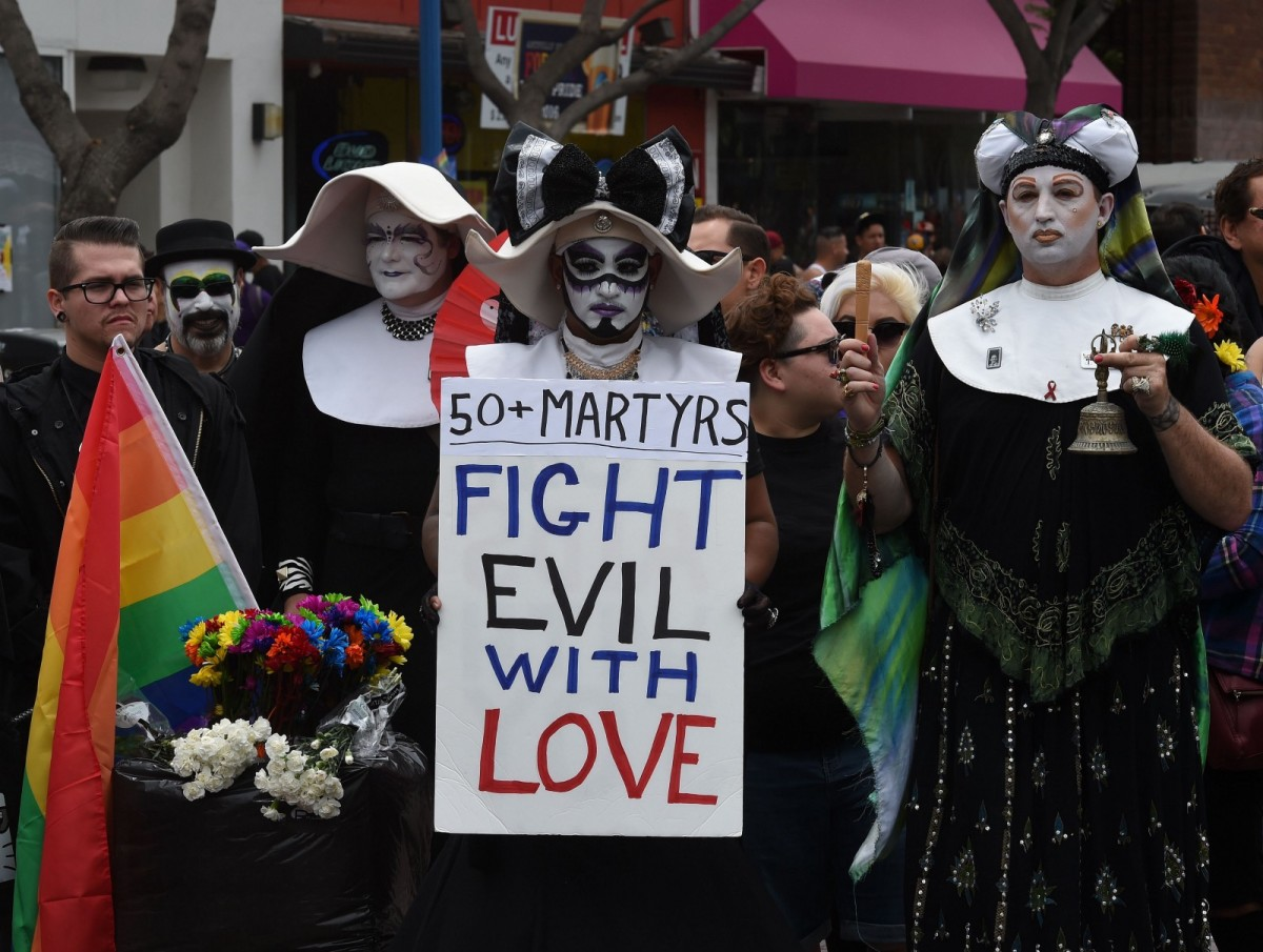 Participants show their support for victims of the Orlando shooting during the 2016 Gay Pride Parade in Los Angeles, California.