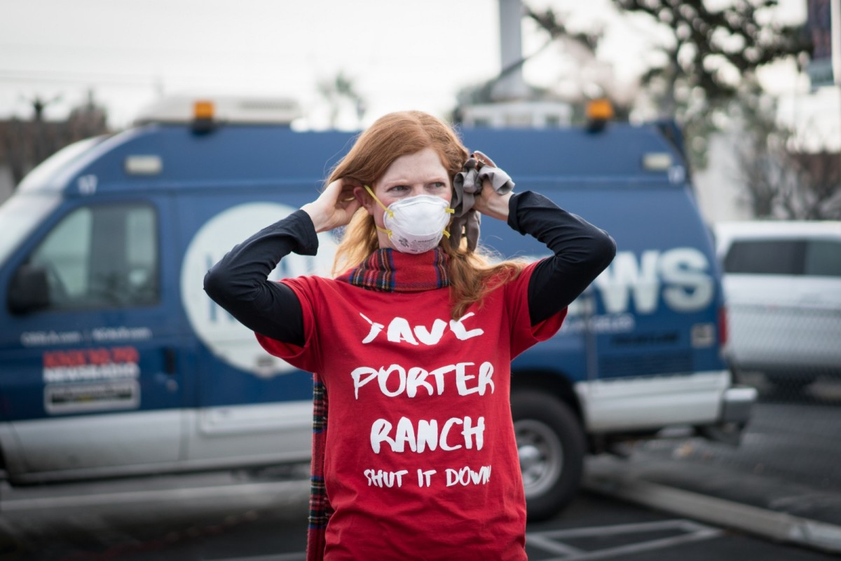 Doctor and activist Leah Garland affixes a gas mask at a rally on January 16th demanding the shut down of the Aliso Canyon oil and gas wells.