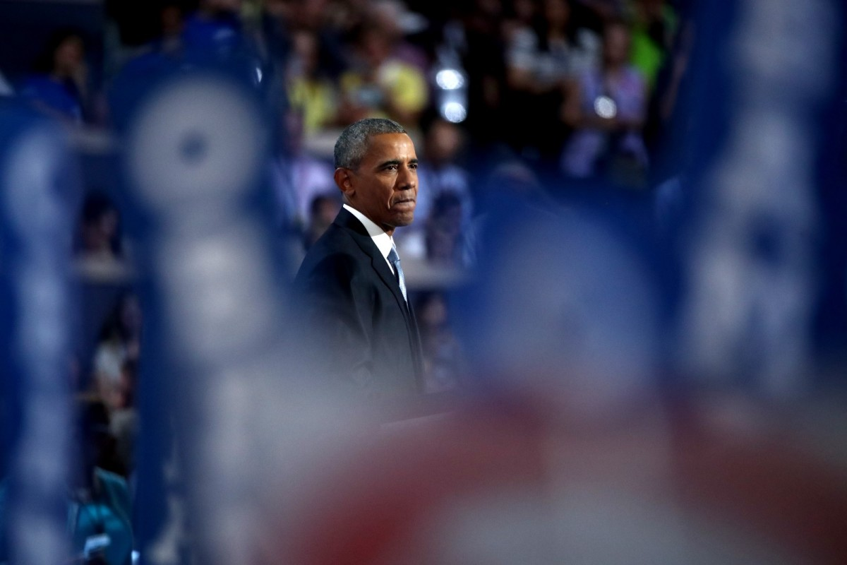 President Barack Obama acknowledges the crowd as he arrives on stage to deliver remarks at the Democratic National Convention.