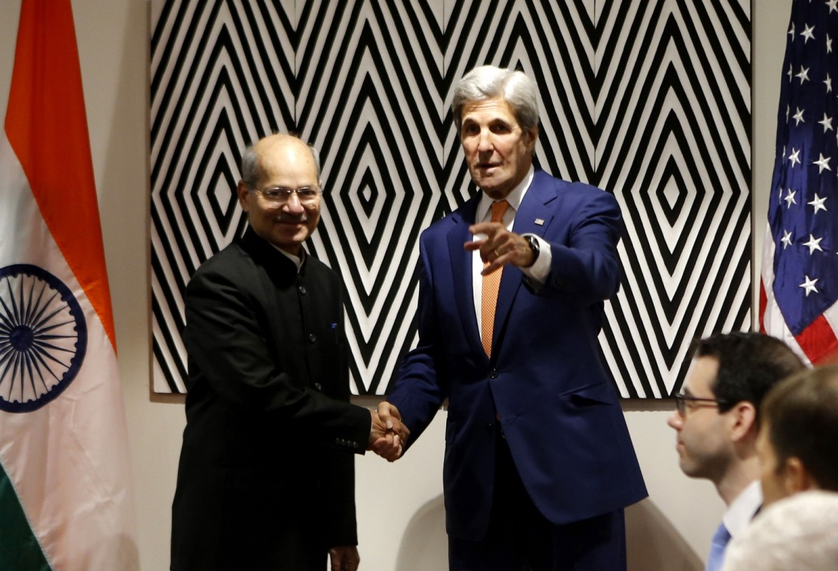 U.S. Secretary of State John Kerry shakes hands with Indian Minister of State for the Environment Shri Anil Madhav Dave at the Montreal Protocol talks in Kigali, Rwanda, on October 14th, 2016.