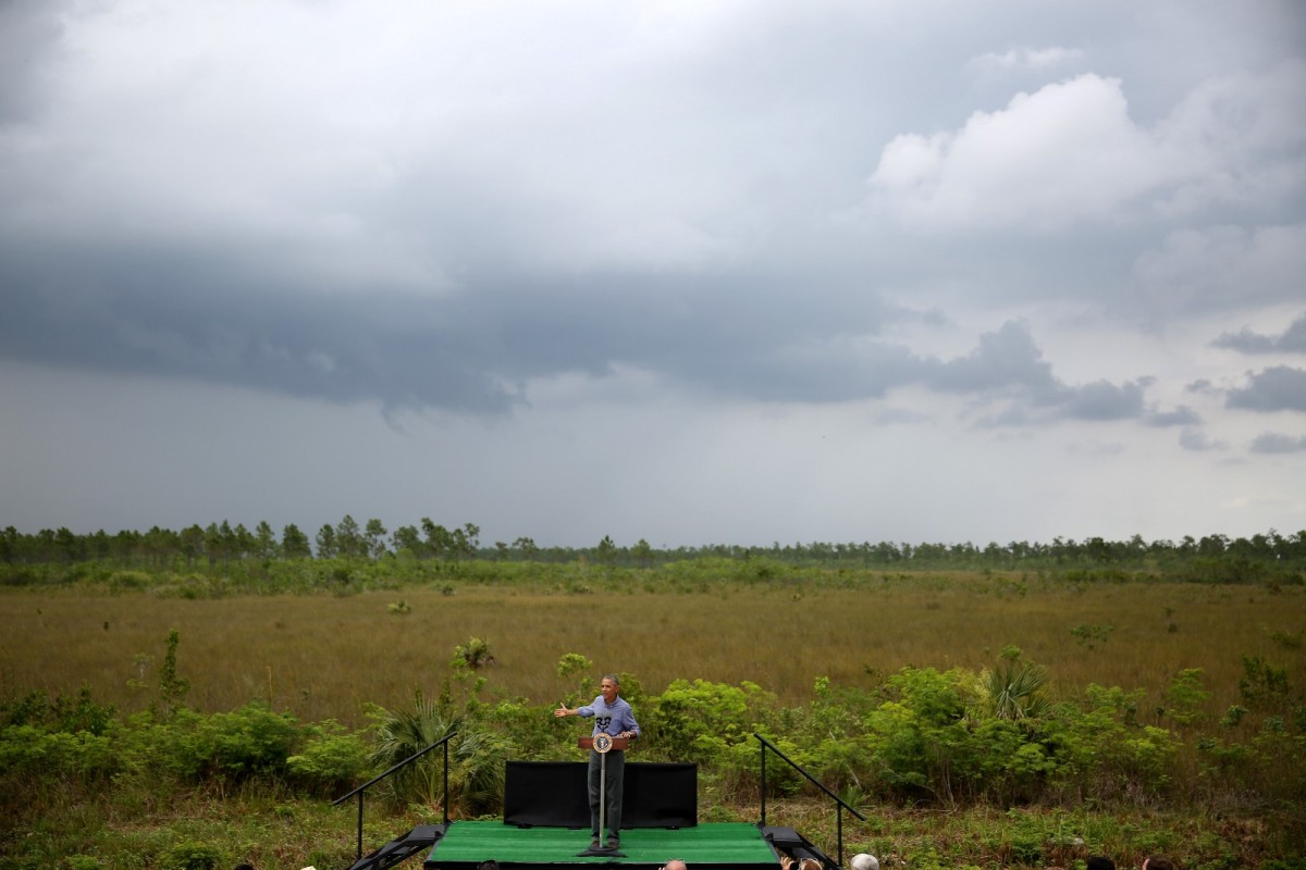 President Barack Obama speaks at the Ernest F. Coe Visitor Center during a visit to the Everglades National Park on April 22nd, 2015, in Homestead, Florida. The President visited the park on Earth Day to speak about the threat that climate change poses to our economy and to the world.