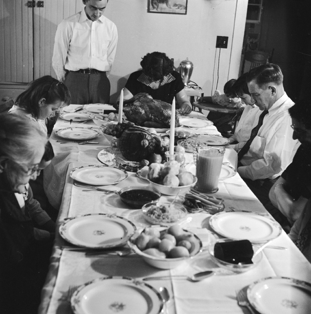 An American family saying pre-Thanksgiving grace, circa 1955.