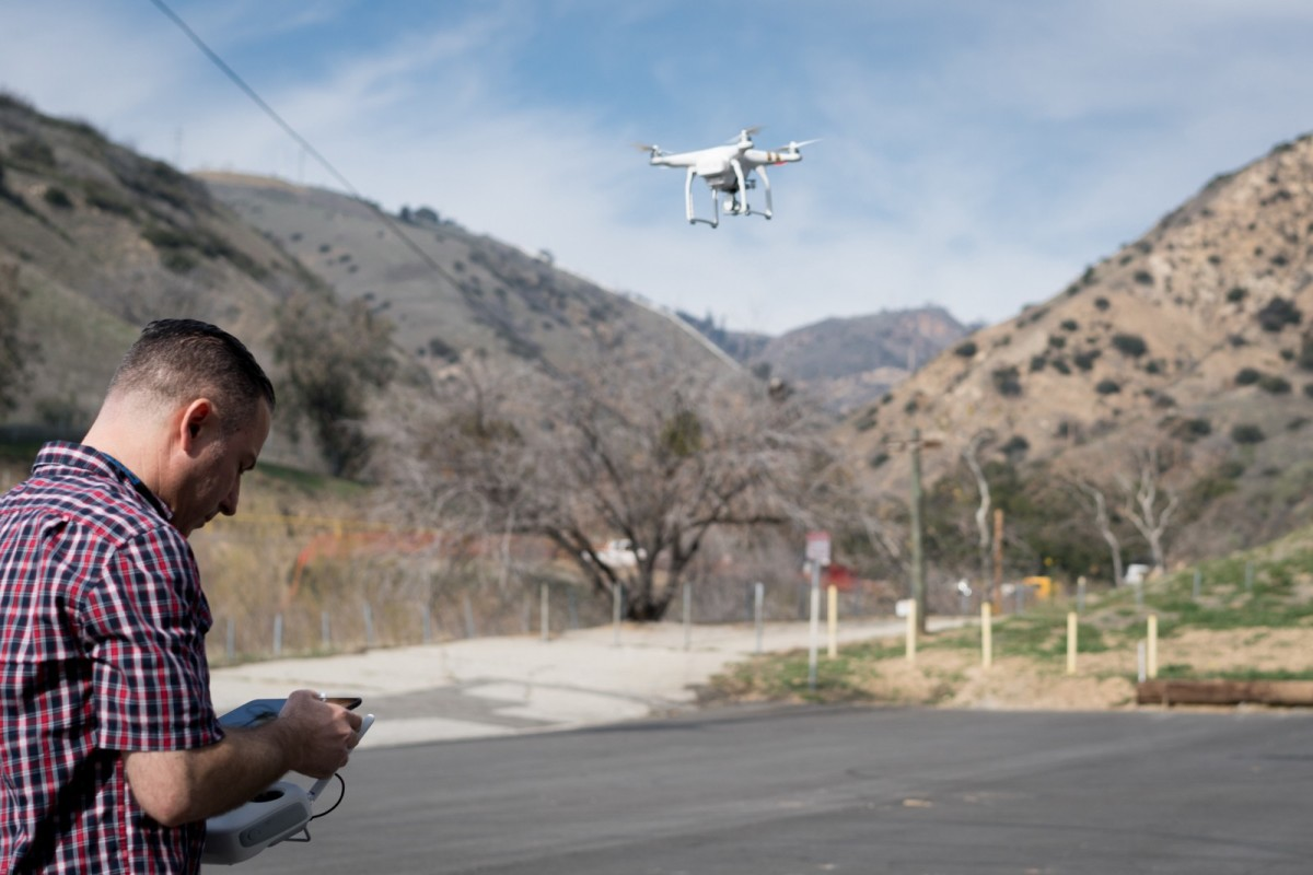 Ammar Abukarah, a longtime resident of Porter Ranch, flies his recreational drone over Aliso Canyon to get a better view of the leak site. Many hiking paths into the canyon have been blocked by the Southern California Gas Company security contractors, leaving curious residents like Ammar to resort to other means to satisfy their curiosity.