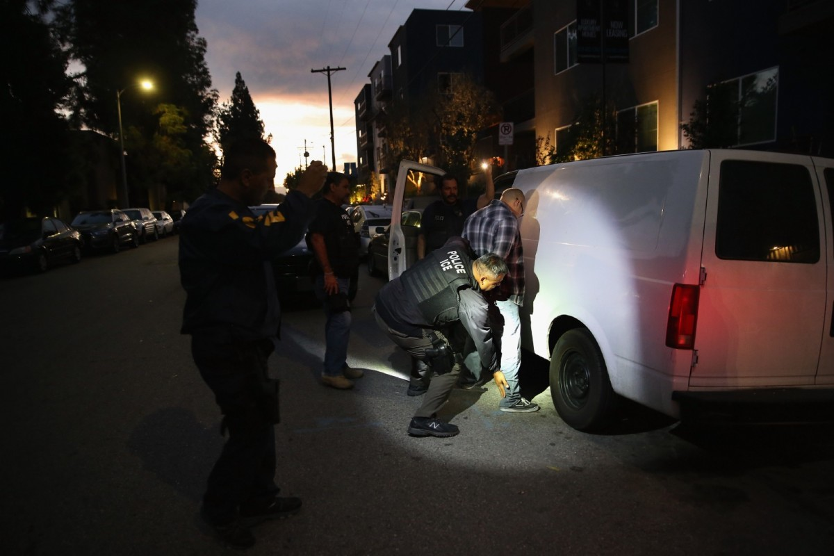 A man is detained by Immigration and Customs Enforcement agents on October 14th, 2015, in Los Angeles, California.