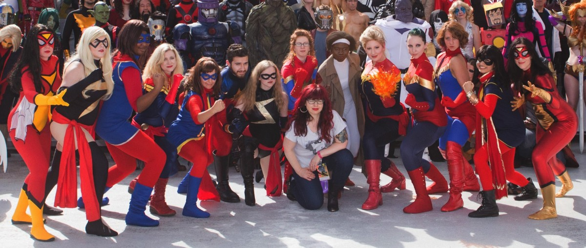 Kelly Sue Deconnick poses with fans of her comic series Captain Marvel & the Carol Corps.