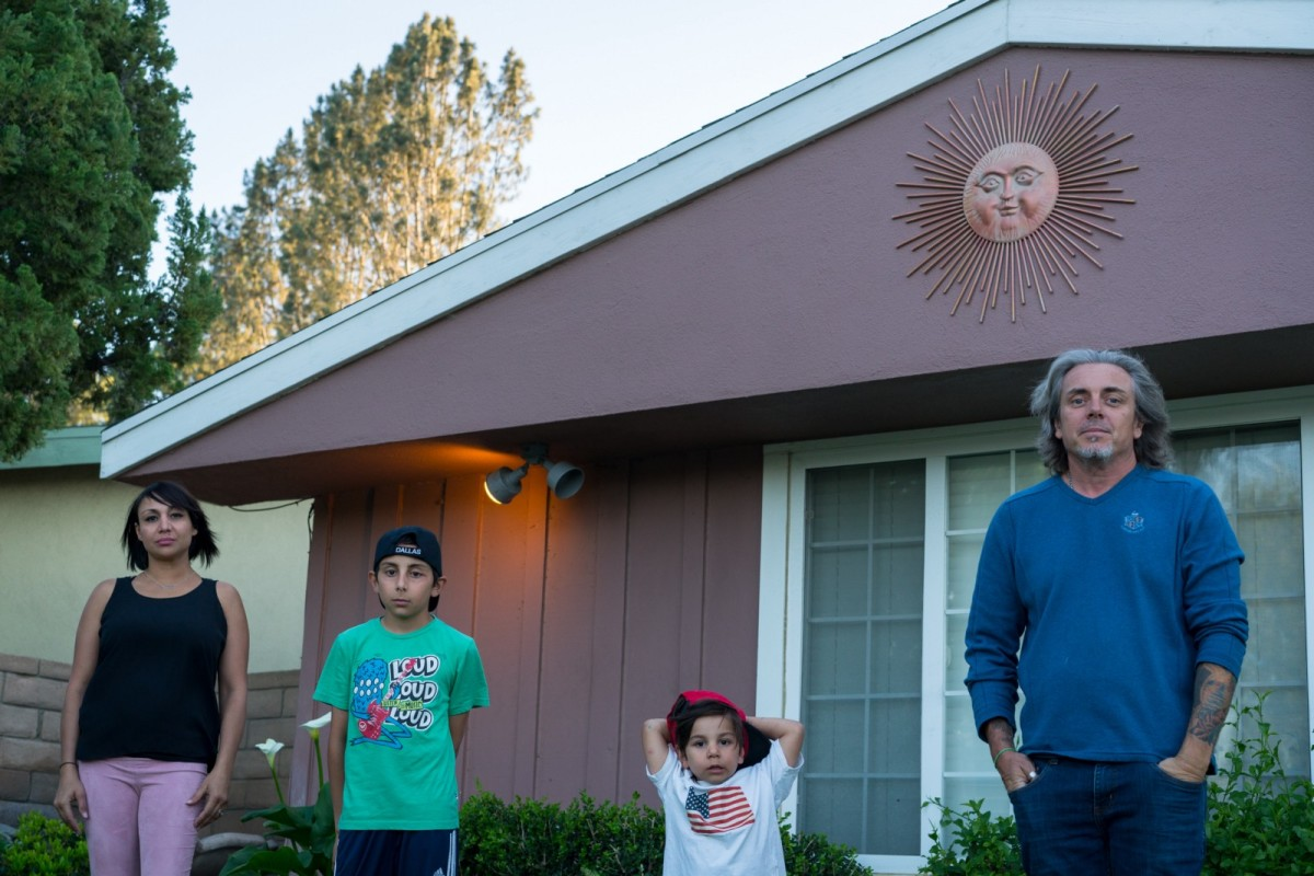 Sandy, Chancellor, Diesel, and Alan Crawford stand outside their home in Granada Hills, which they have temporarily vacated due to nosebleeds and other health issues related to the nearby gas leak. Depending on the winds in the canyon, many communities other than Porter Ranch also reported health issues.
