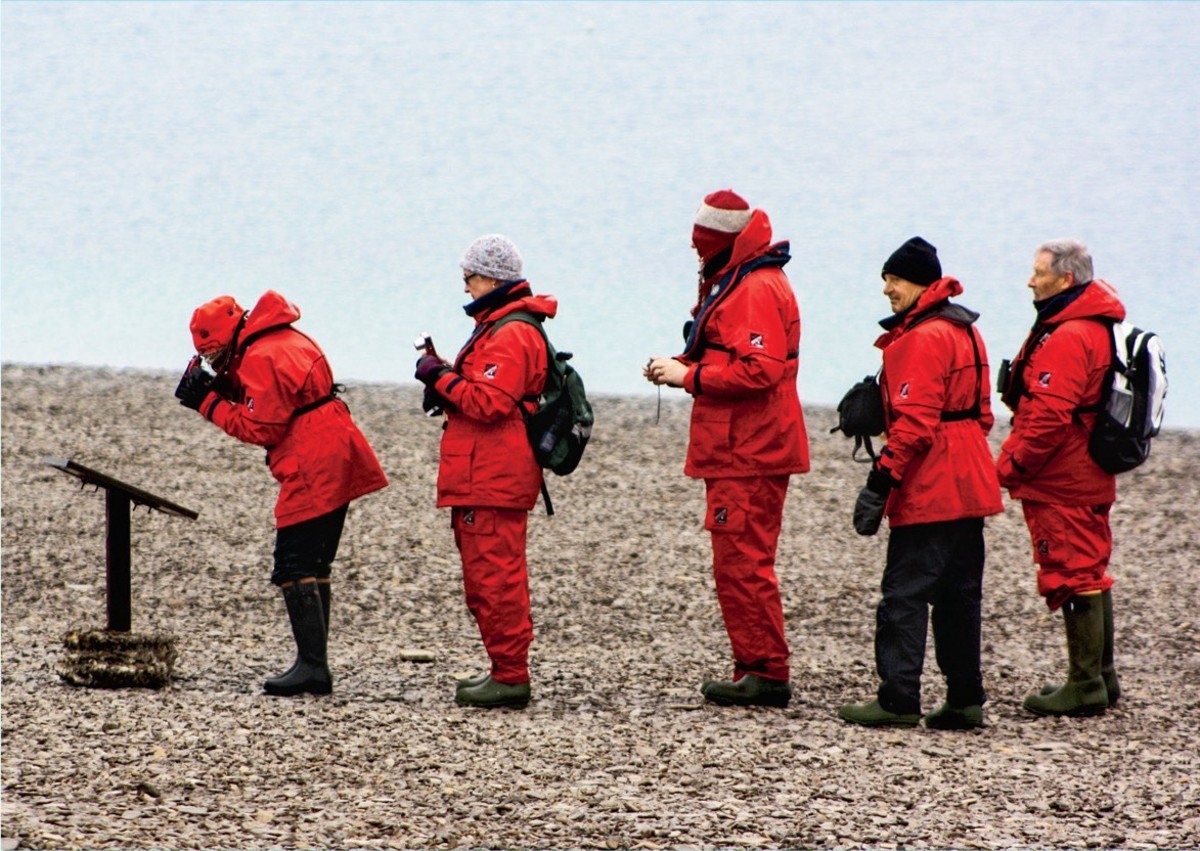 Lining up for a plaque on Beechey Island in the Canadian Arctic Archipelago of Nunavut, Canada.