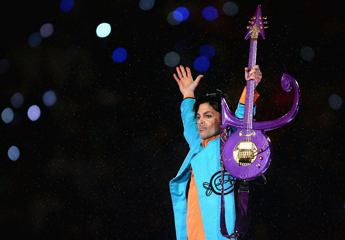Prince performs during the Pepsi Halftime Show at Super Bowl XLI on February 4th, 2007, in Miami Gardens, Florida.