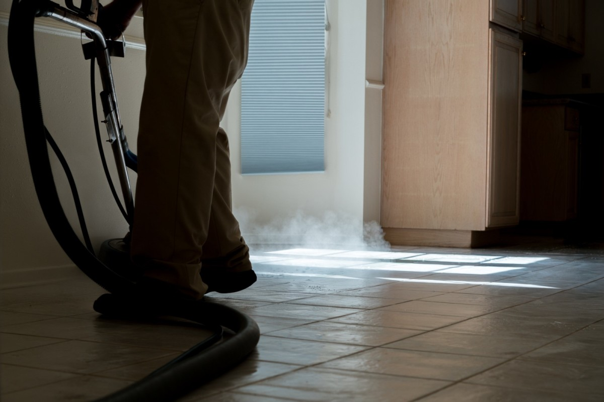 A man from a cleaning service washes the floors of a recently vacated home on Dunure Place in Porter Ranch on March 26. The home, which is up for sale, was vacated by the previous owners because of the gas leak. This is the second time it has been cleaned, according to the man.