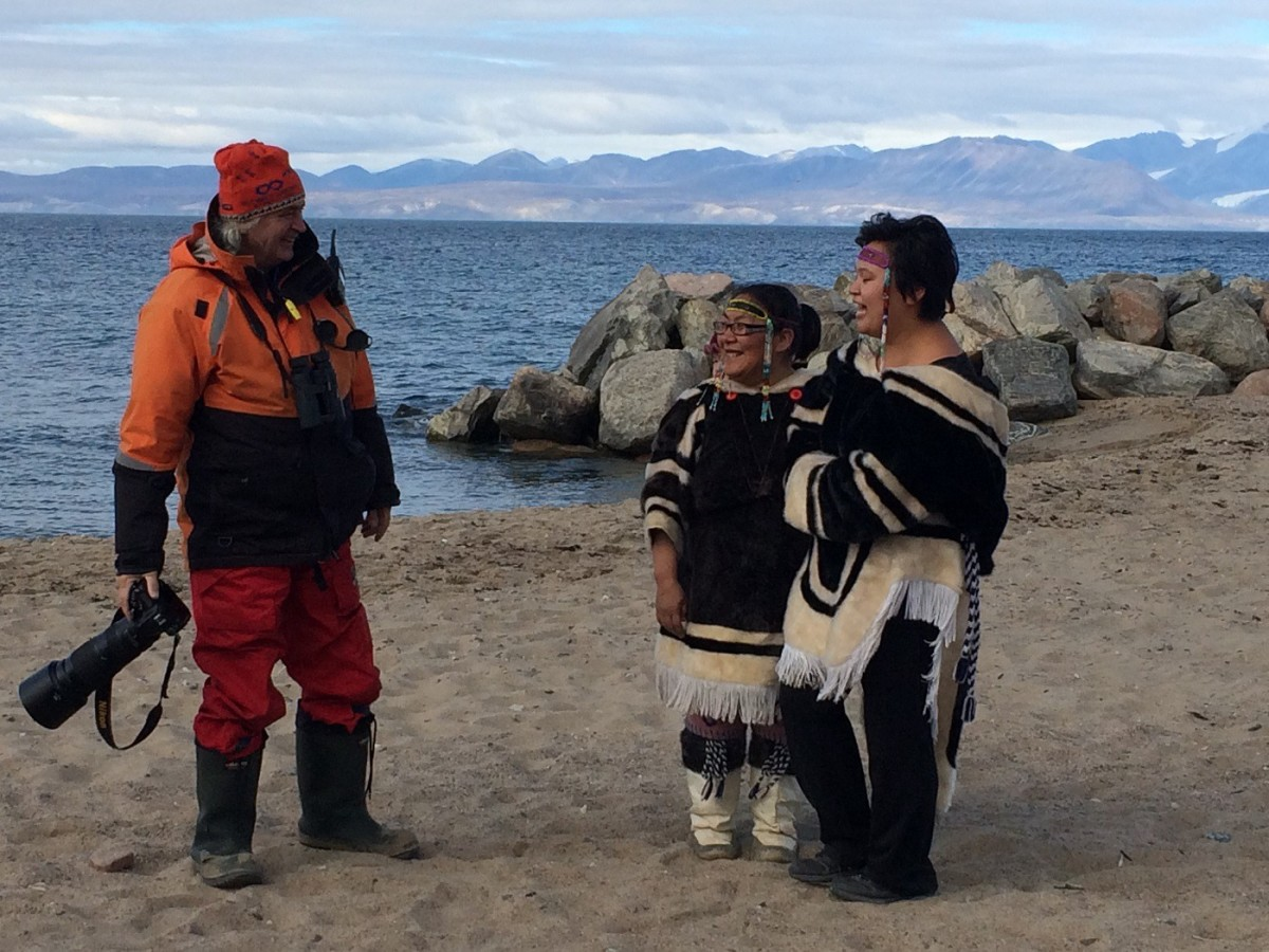 "A welcoming committee met us on the beach in traditional sealskin amautis. We'd been coached to ask locals for permission before taking their photograph, and when someone asked these women if a photo would be OK, one of them laughed and replied ""Why do you think we're dressed like this?"""
