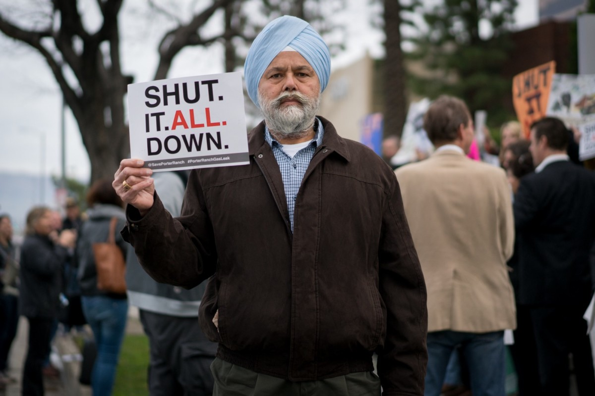 "Gurbux Singh of Chatsworth protests on January 23rd outside of the Hilton Hotel in Woodland Hills before a public hearing concerning the natural gas storage facilities in Aliso Canyon. Singh says the community will ""keep fighting"" until the gas storage facilities surrounding nearby residential areas are permanently shut down."