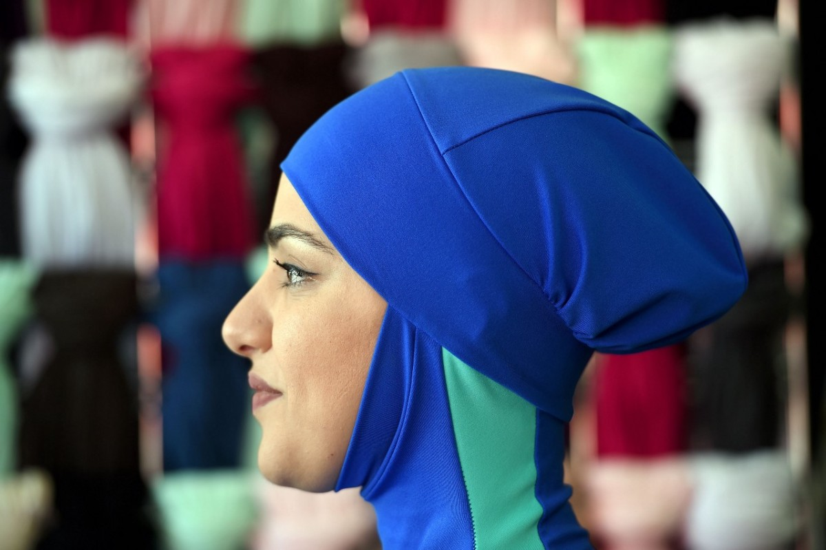 Profile photo of the head of a woman wearing a burkini swimsuit