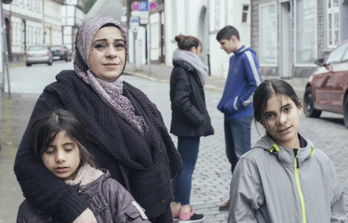 In Watani: My Homeland, Hala Kamil (above) flees Syria with her four children for Germany.