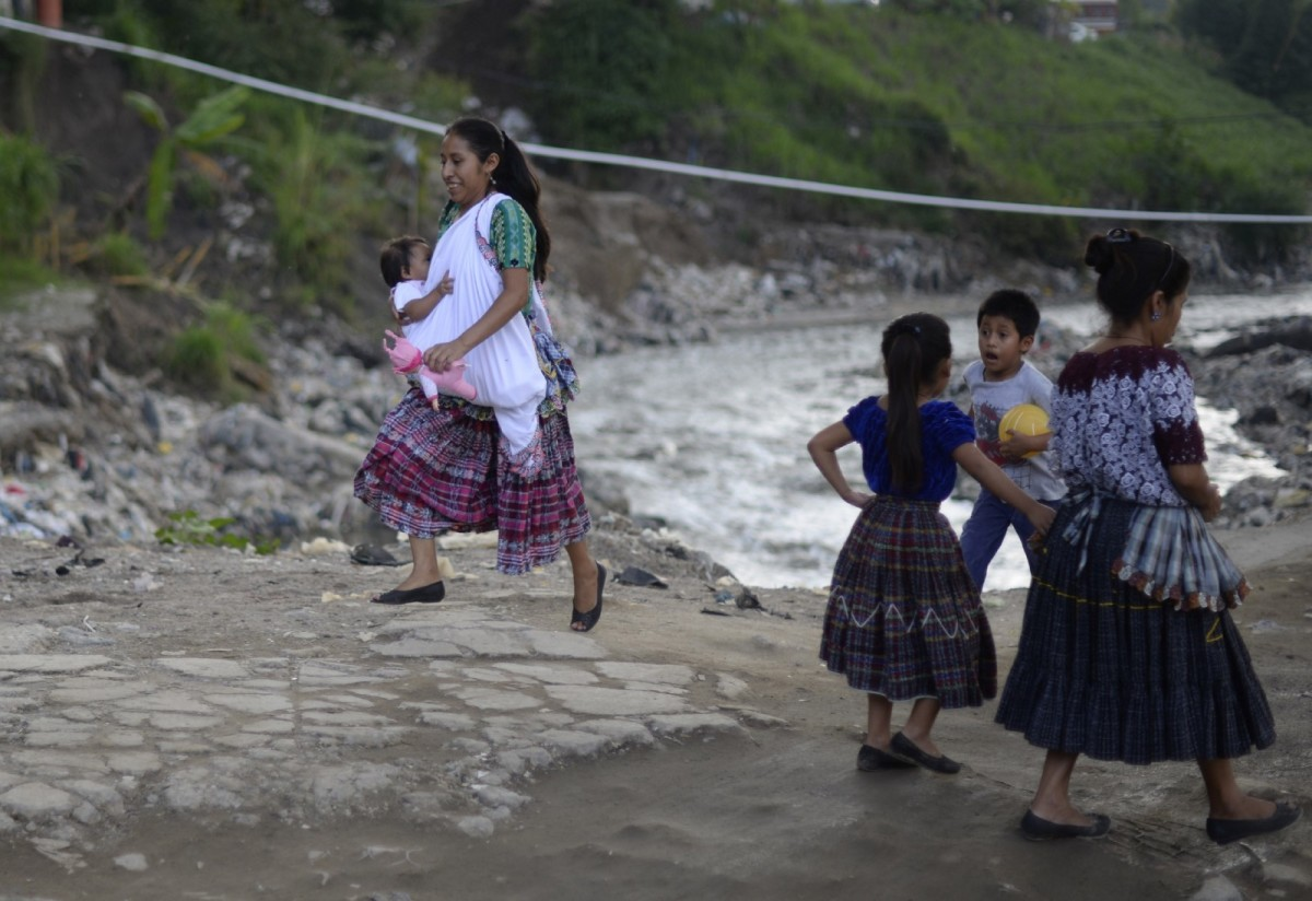 An indigenous woman walks with her baby in Chinautla municipality, 15 kilometers north of Guatemala City, October 25th, 2015.