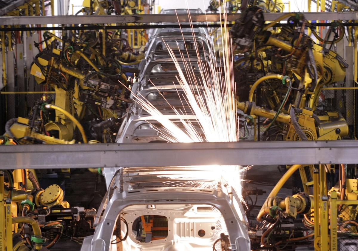 SUVs are welded by robot arms as they go through the assembly line at the General Motors Assembly Plant in Lansing, Michigan.