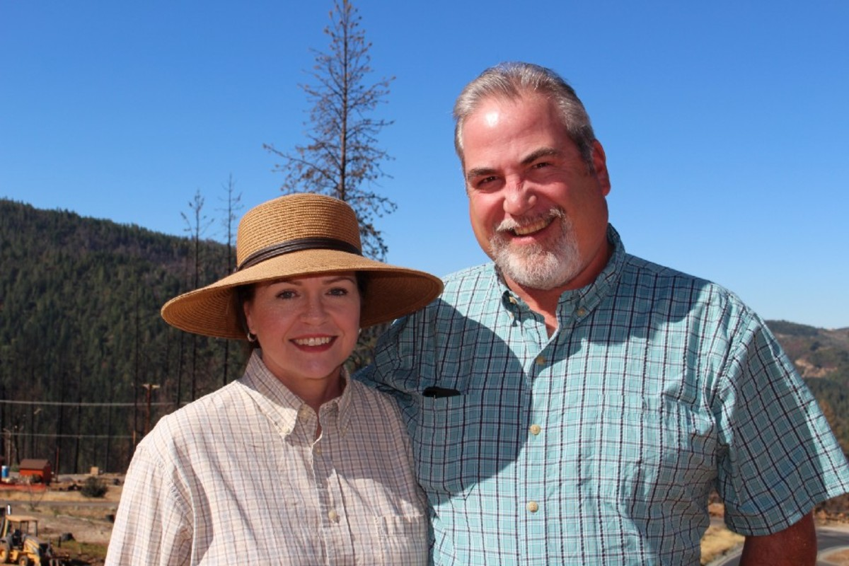 Sue and Devin Hoberg on their property one year after the Valley Fire.