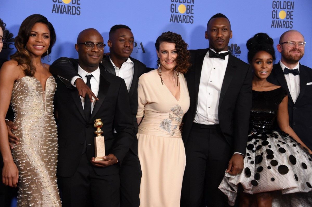 The cast and creators of Moonlight pose with the Best Motion Picture Drama award at the 74th Annual Golden Globe Awards.
