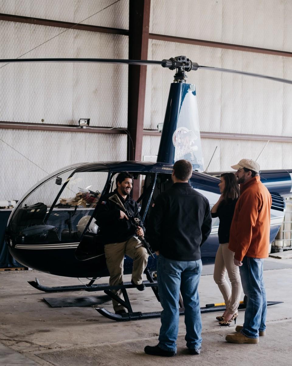 The Helibacon team debriefs after a flight. (Photo: Benjamin Rasmussen)