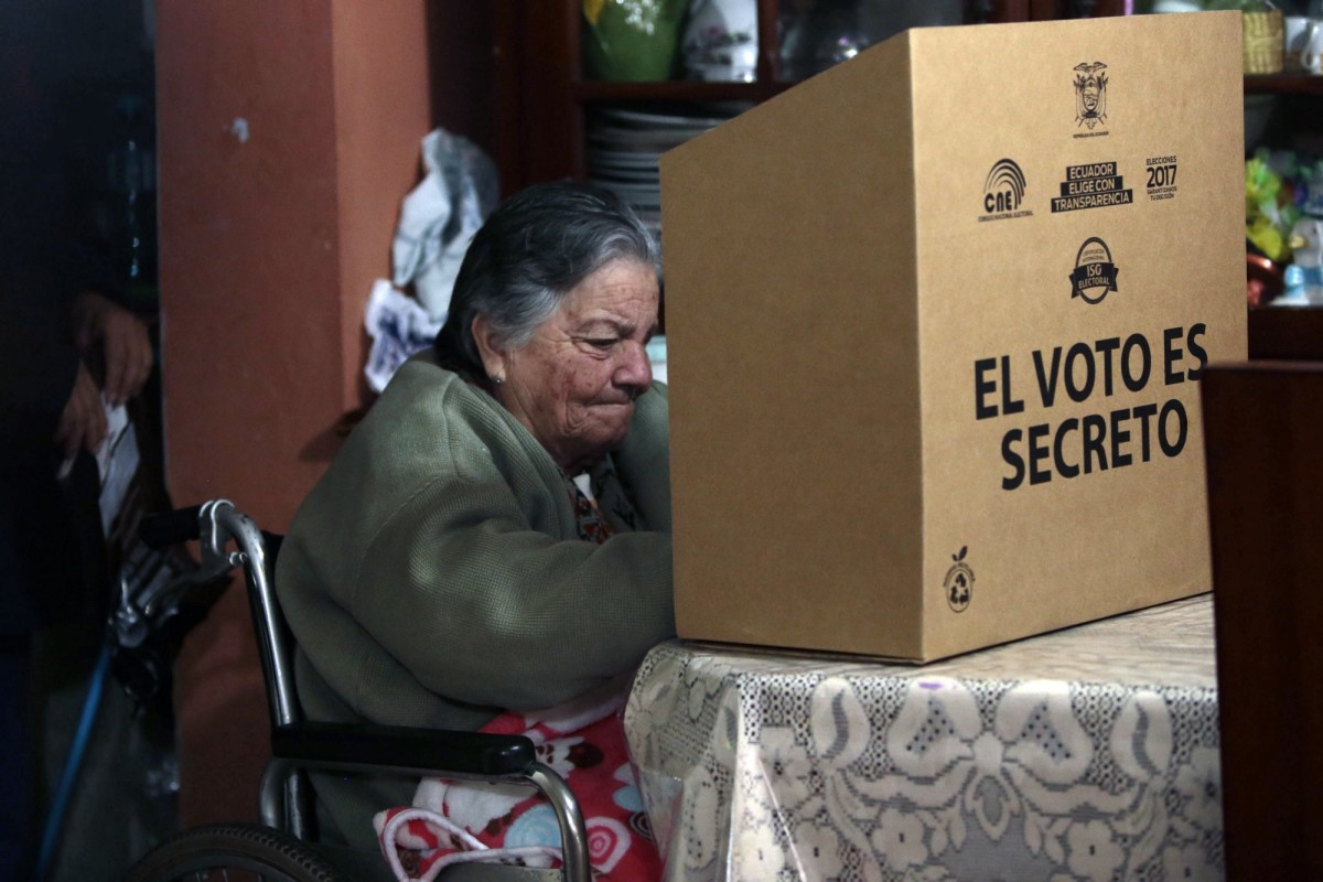 A woman casts a vote at her house on March 31st, 2017, ahead of Ecuador's presidential runoff Sunday. (Photo: Juan Cevallos/AFP/Getty Images)