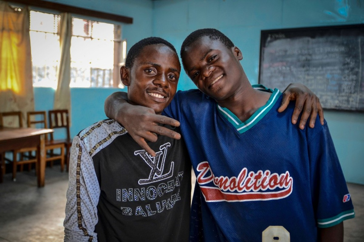 Lifeke Mboyo (right) says dance gives him a sense of belonging. Born deaf, he memorizes the timing of the dance steps through counting and with the help of an interpreter. Believed to be cursed or possessed by evil spirits, people living with disabilities are often excluded from mainstream education and jobs in Congolese society.