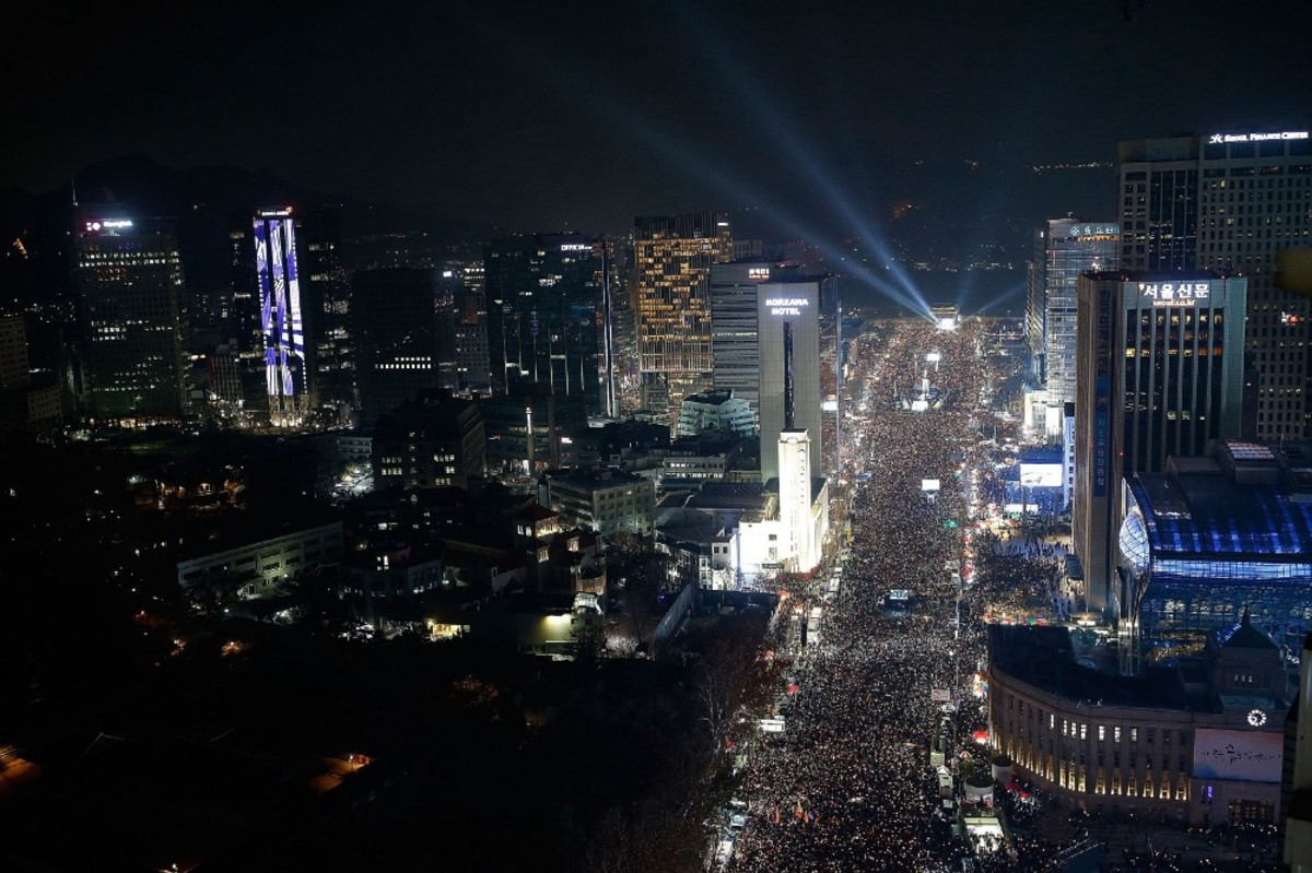 Protesters gathered and occupied major streets in the city center of Seoul for a rally against South Korean President Park Geun-hye on December 3rd, 2016. (Photo: Pool /Getty Images)