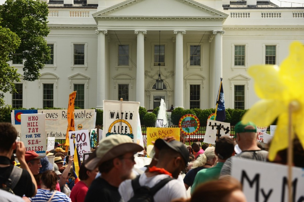 People march near the White House during the People's Climate Movement in Washington, D.C., on April 29th, 2017.