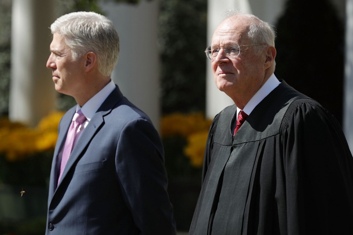 Supreme Court Associate Justice Anthony Kennedy (right) prepares to administer the judicial oath to Judge Neil Gorsuch during a ceremony in the Rose Garden at the White House on April 10th, 2017, in Washington, D.C. (Photo: Chip Somodevilla/Getty Images)