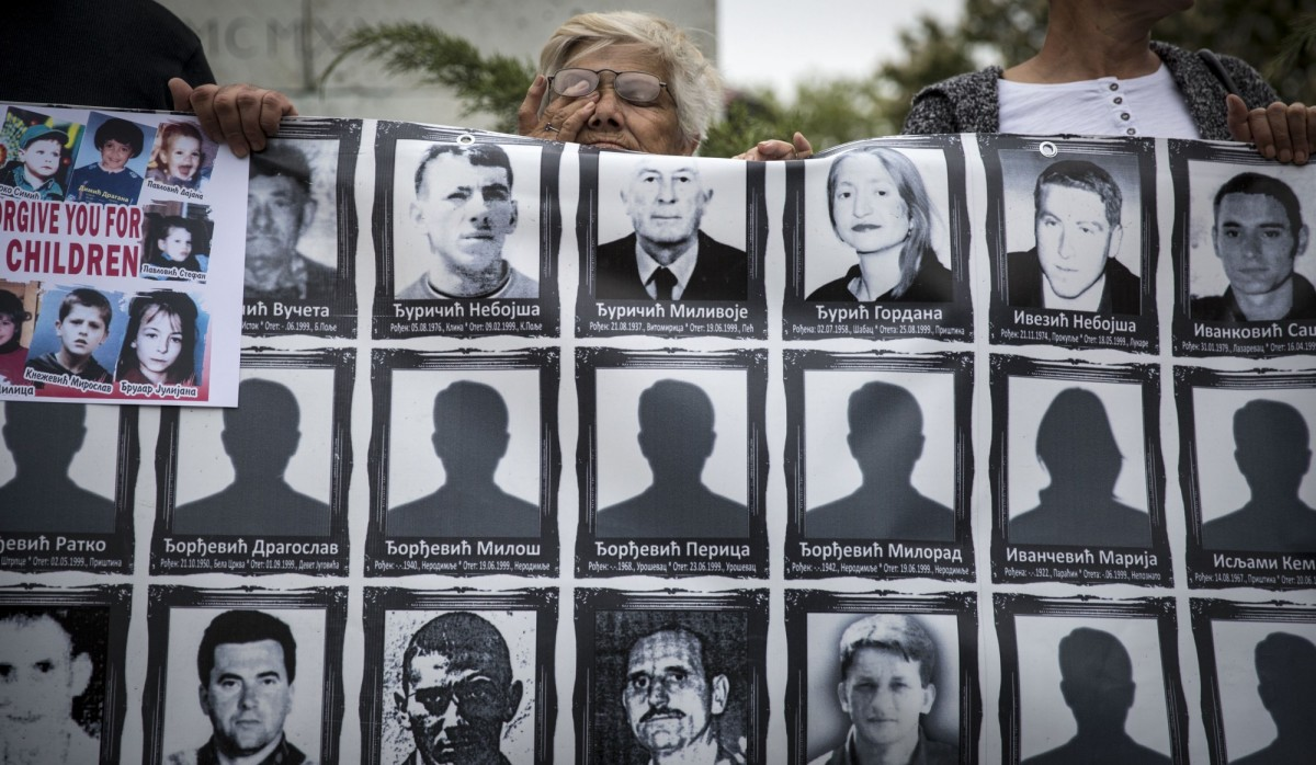 A member of the Association of Families of Kidnapped and Murdered Persons in Kosovo and Metohija holds a banner depicting missing and killed relatives during a protest rally in Belgrade, Serbia, on April 28th, 2017. (Photo: Oliver Bunic/AFP/Getty Images)INLINE