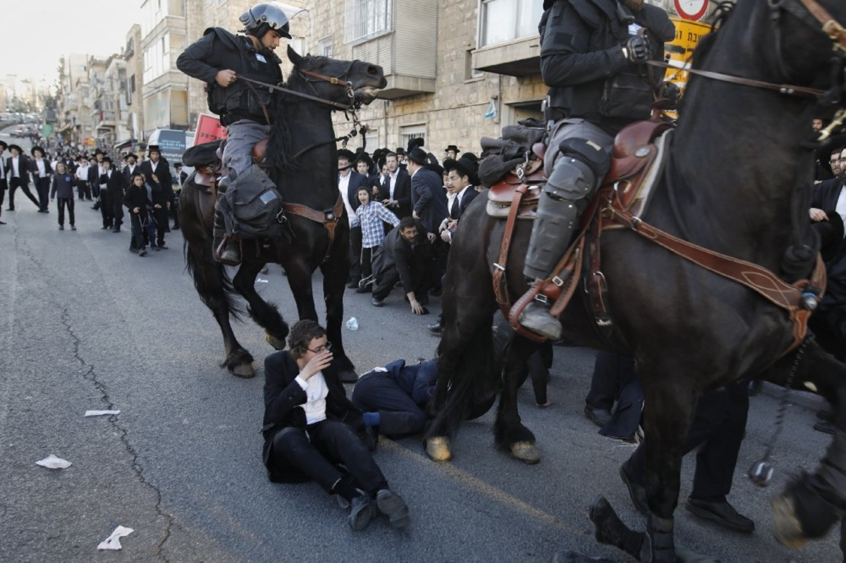 Mounted policemen disperse Orthodox Jews in the center of Jerusalem during a protest against Israeli army conscription on April 3rd, 2017. (Photo: Menahem Kahana/AFP/Getty Images)