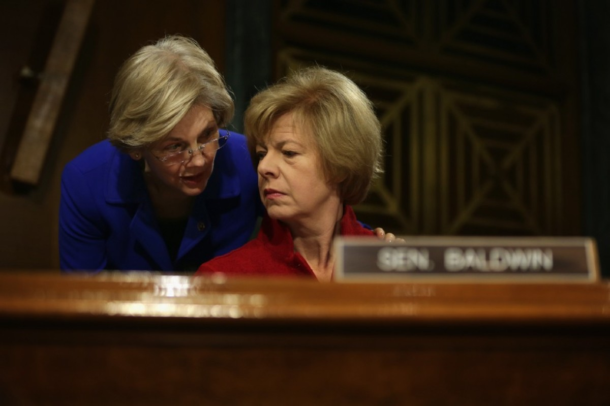 Senator Elizabeth Warren (D-Massachusetts) talks to Senator Tammy Baldwin (D-Washington) during a hearing before Senate Health, Education, Labor and Pensions Committee on February 10th, 2015. (Photo: Alex Wong/Getty Images)