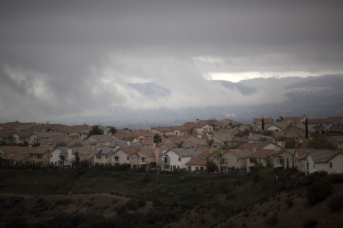 Following a massive natural-gas leak, storm clouds hang over the Porter Ranch neighborhood of the of California's San Fernando Valley on December 22nd, 2015. (Photo: David McNew/AFP/Getty Images)