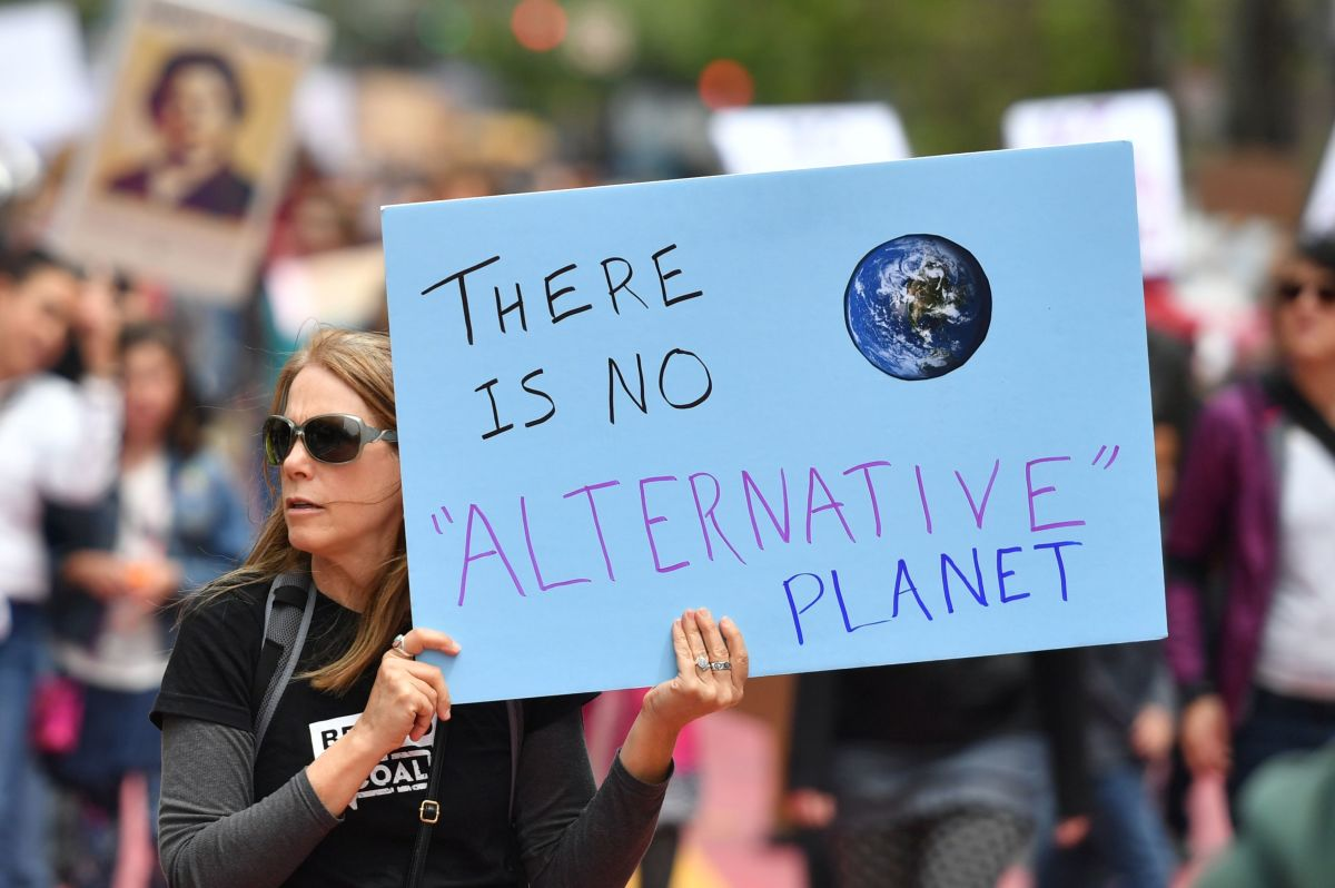 People hold signs during the March for Science in San Francisco, California, on April 22nd, 2017.
